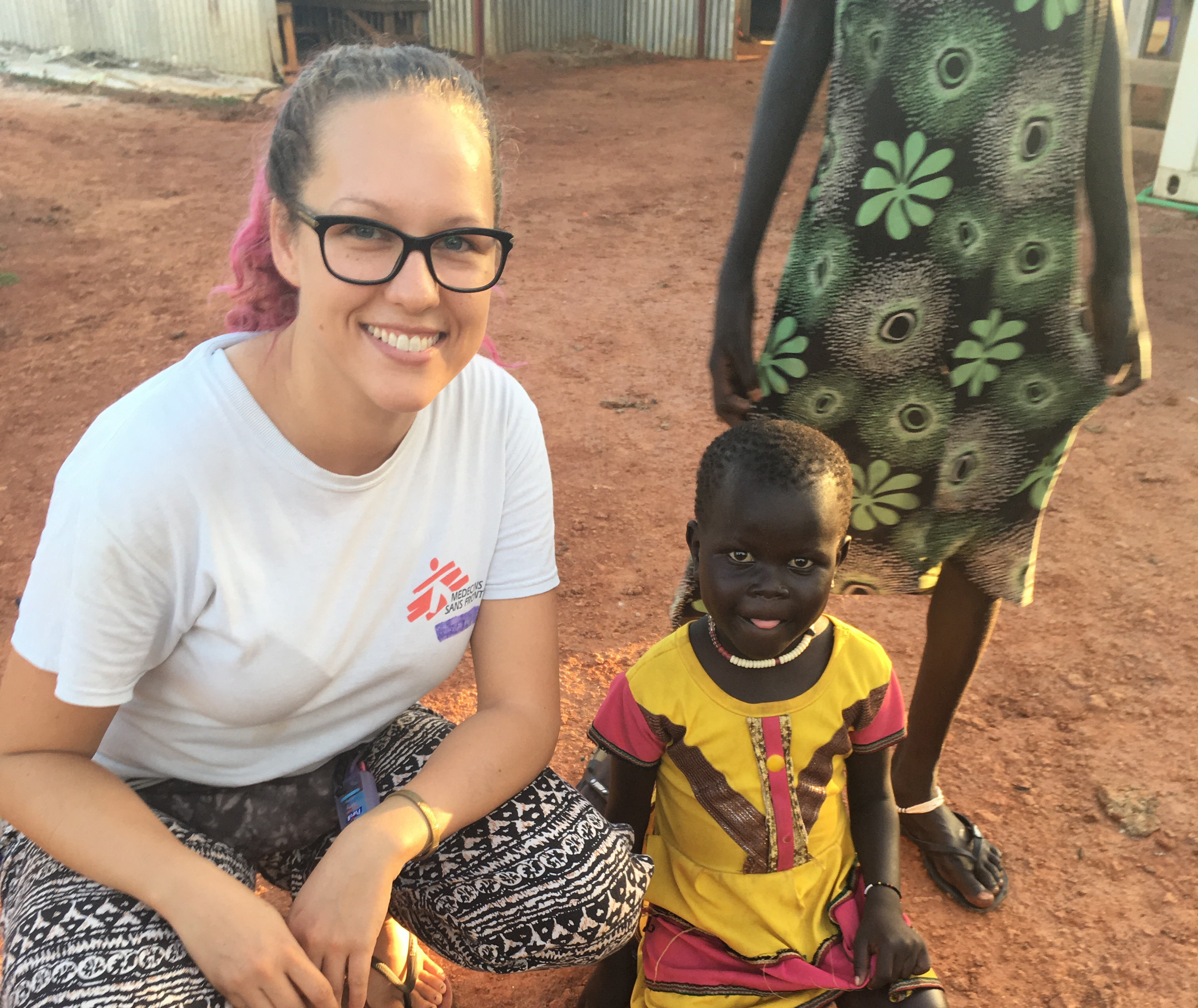Doctors Without Borders nurse, Samantha Hardeman, with a young patient in South Sudan.