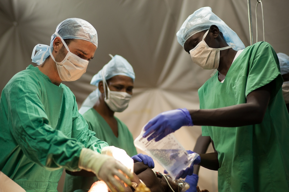 Doctors Without Borders Surgery Staff Treat A Young Patient