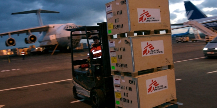 A forklift carrying boxes of Doctors Without Borders supplies.