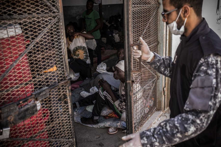 A guard closes the door of a cell in Abu Salim detention center, in Tripoli, Libya.