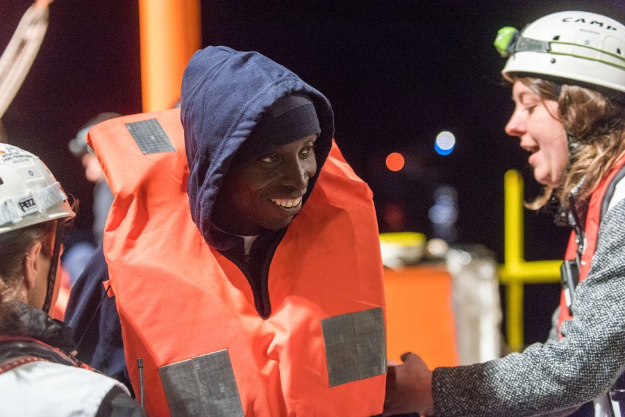 Dominika Wanczyk talks with a rescued migrant after an operation that pulled 99 people out of a sinking boat.