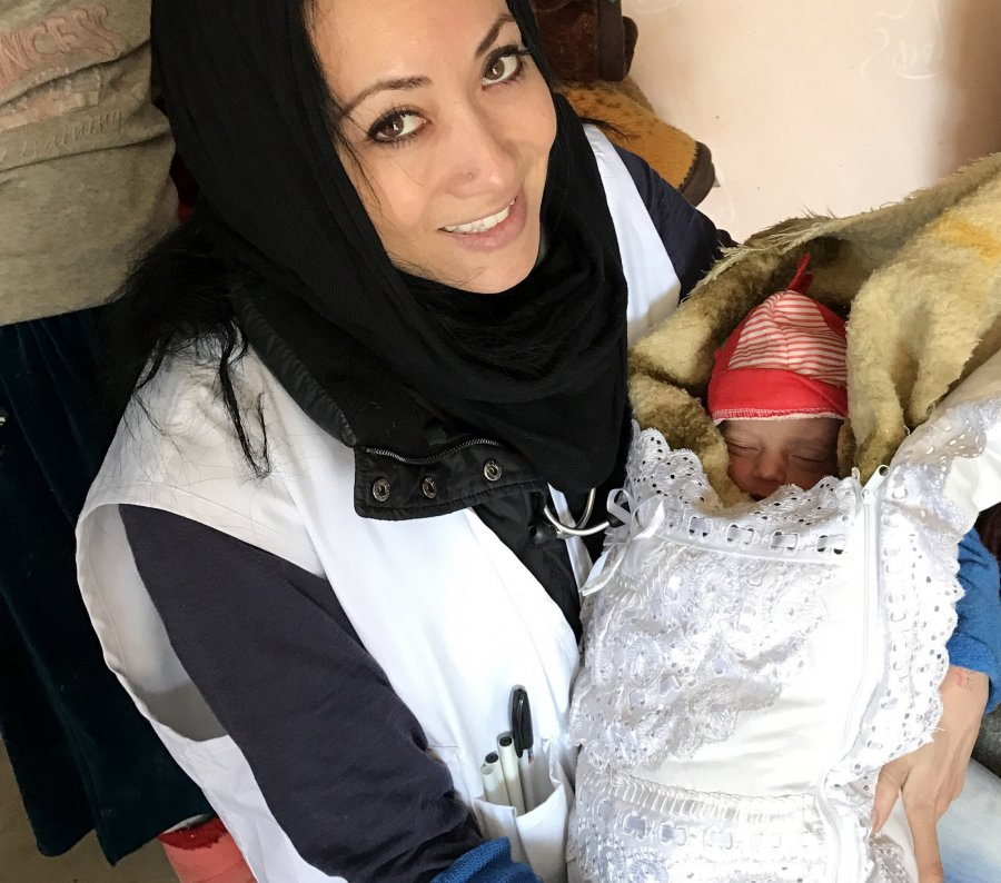 Canadian MSF nurse holding a baby