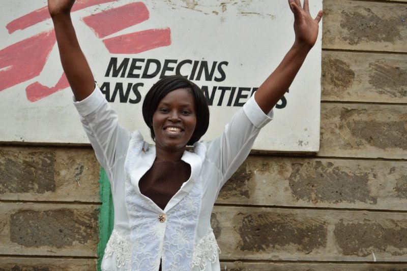 Elizabeth Wangeci in smiles and expressing her happiness in a picture