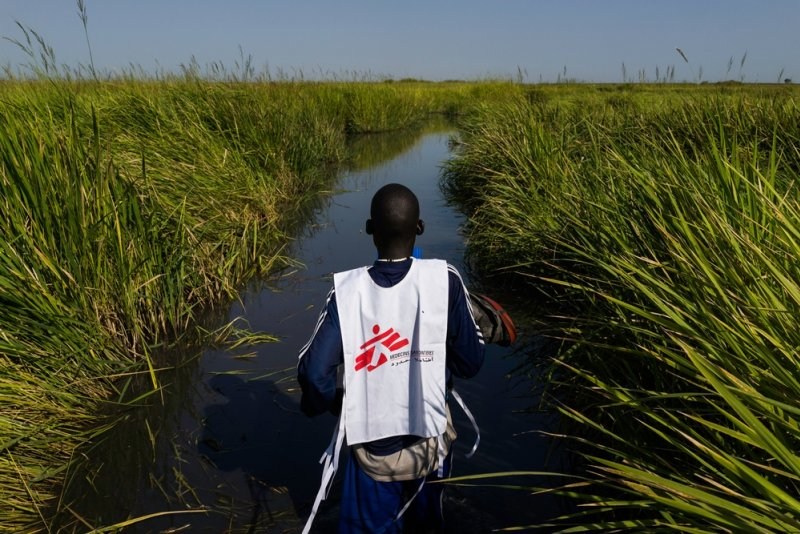 A Doctors Without Borders staff member travelling by boat.
