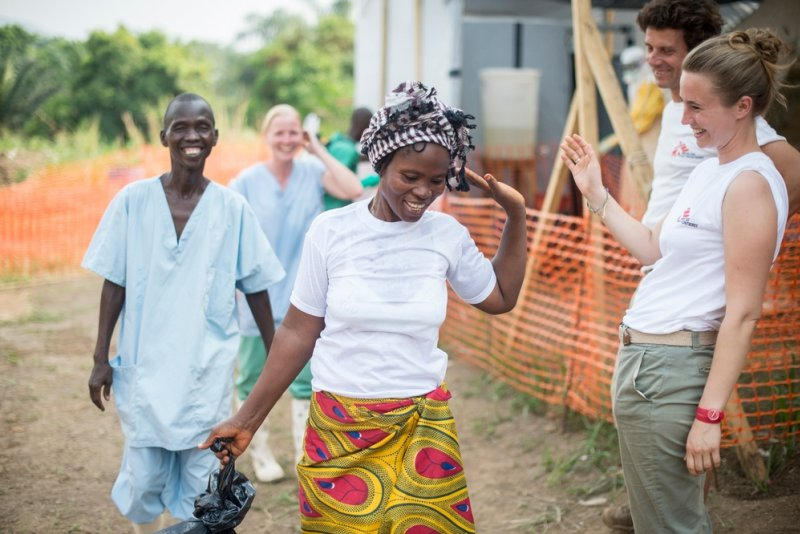 A patient happily leaves an Ebola treatment centre.