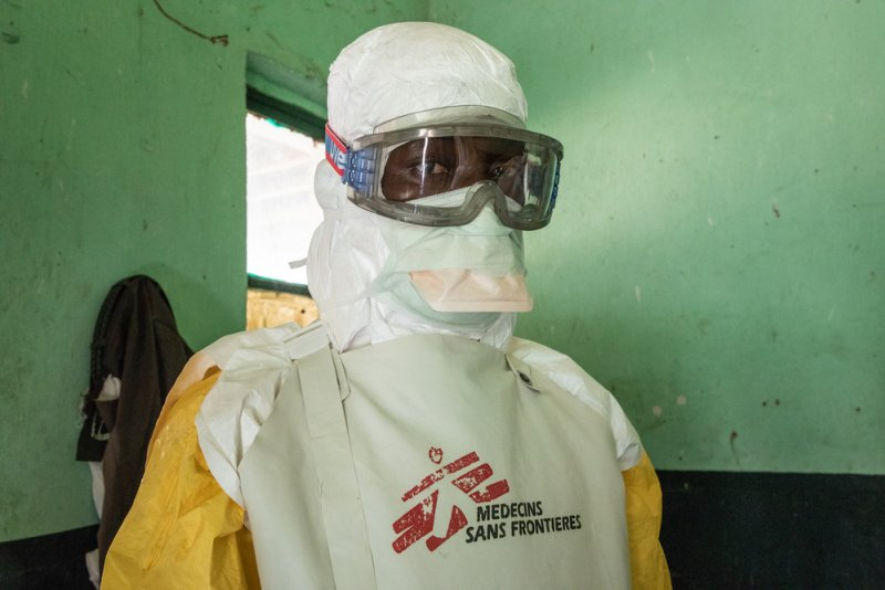 A Doctors Without Borders staff member getting dressed in a protective suit in the Ebola Treatment Centre in Bikoro, Democratic Republic of Congo.