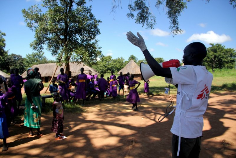 An MSF member gives instructions to the crowd of primary school students