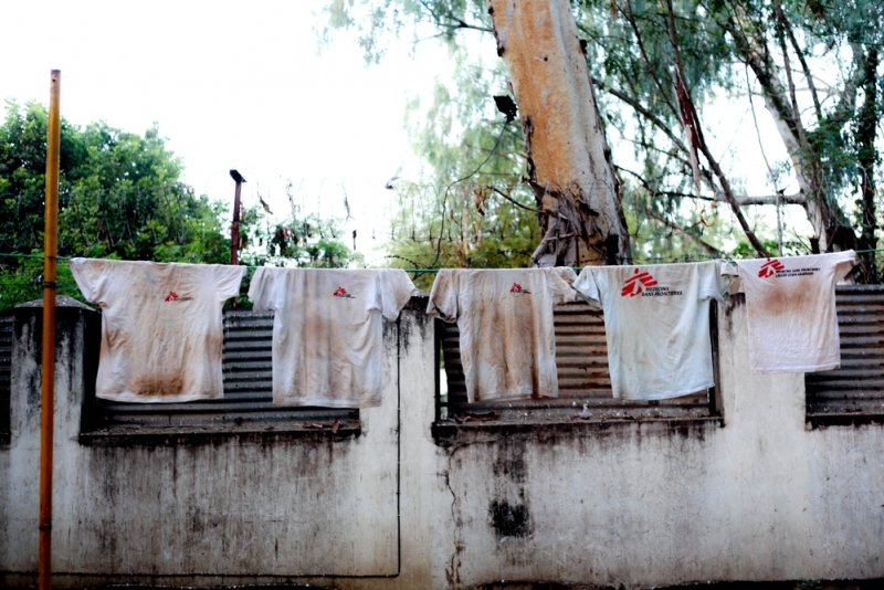 Doctors Without Borders t-shirts drying on a clothes line.