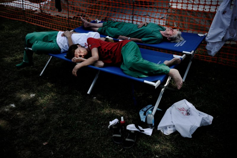 Tired Doctors Without Borders staff members take a nap on stretchers outdoors at the hospital in Leogane.