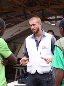 MSF worker discuss with other 2 men